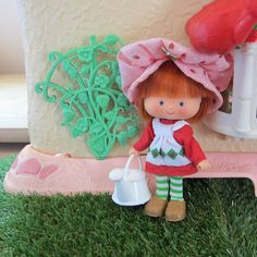 Strawberry trellis outside Berry Happy Home dollhouse