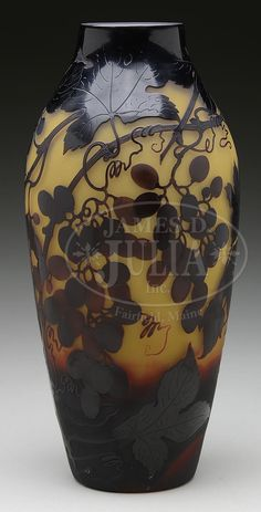 """D'ARGENTAL CAMEO GRAPE VASE. D'Argental vase has detailed cameo leaves, vines and grapes done in dark purple against a yellow shading to red/brown background. Signed on the side in cameo """"D'Argental"""" with the cross of Lorraine."""
