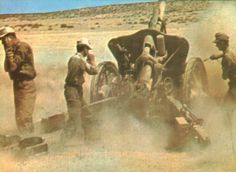 German gunners firing of 105-mm howitzers in North Africa