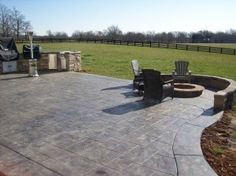 hot tub on stamped concrete with fire pit and seat wall by parrot ... - Patio Stamped Concrete Ideas