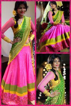 Pink lehanga with pink floral, yellow and green triple border. Pink full sleeved blouse and green dupatta. Langa oni/ half saree/ ghagra choli. Golden Threads by Kavita and Dhanya Gutta.
