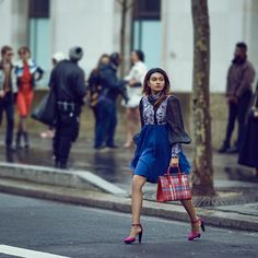 Twinkle Mukherjee carries The Strathberry Midi Tote in Ruby Tartan