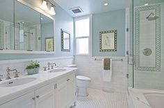 The master bathroom features a stand-up shower and separate tub as well as dual sinks. The property, which was originally built in 1917, was completely remodeled in 2006. Photo: OpenHomesPhotography.com