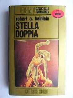 """Il romanzo """"Stella doppia"""" (""""Double Star"""") di Robert A. Heinlein venne pubblicato per la prima volta nel 1956, prima sulla rivista """"Astounding Science Fiction"""" e poco dopo come libro. Nel 1957 ricevette il Premio Hugo come miglior romanzo dell'anno. Copertina di Dino Marsan per la seconda edizione in """"Cosmo Oro"""". Clicca per leggere la recensione del romanzo!"""
