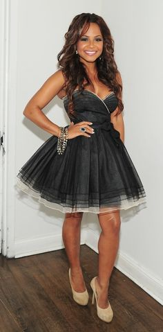 Christina Milian. i would do ANYTHING to be as pretty and adorable as her