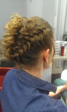 This hairstyle is perfect for managing curly or frizzy hair. dutch braid into messy bun. cute
