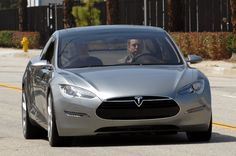 Tesla Model S - the future of motoring. CEO Elon Musk in the driver's seat!
