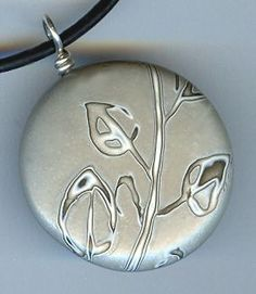 Silver Leaves, mokume gane pendant made from polymer clay by Rebecca Geoffrey.