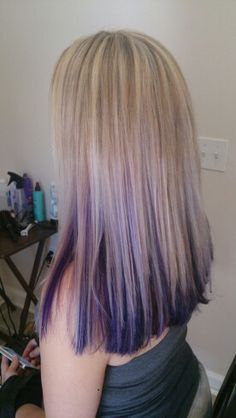 Light blonde highlights with purple peekaboo underneath