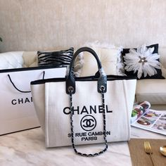 Bags Type: Single shoulder bag with two handles and shoulder strapsClosure Type: Magnetic claspMaterial: High grade PU , interior single zipper side pocket Dimensions: Strap: Metal and leather twined adjustable Chanel Tote Bag, Chanel Handbags, Dior Saddle Bag, Saddle Bags, Louis Vuitton Heels, Chanel Canvas, Chanel Glasses, Kendall And Kylie Jenner, Best Bags