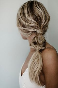 Updo hairstyle for bridesmaid - twisted, side pony - bridesmaid hair idea {Courtesy of Ash and Co.}