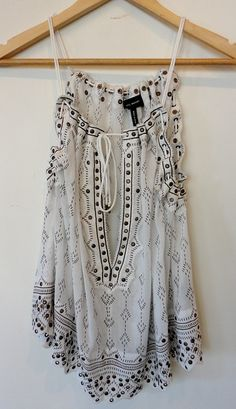 LOVE this top with a black lace bandeau or a pop of color! Could even wear it as a bathing suit cover up!