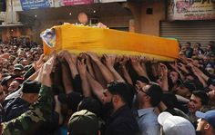 May 21, 2013 - ARTICLE - HEZBOLLAH - LEBANON - ELITE TROOPS - Supporters of Hezbollah and relatives of Hasan Faisal Sheker, an 18-year-old Hezbollah member, carry the coffin during his funeral in Nabi Sheet near Baalbeck. About 30 Lebanese Hezbollah fighters and 20 Syrian soldiers and militiamen loyal to President Bashar al-Assad have been killed in the fiercest fighting this year in the rebel stronghold of Qusair, Syrian activists said on Monday.