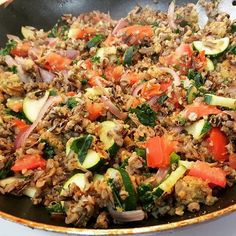 Fried wild rice.  wild rice and fried it with onions, zucchini tomatoes, spring onions & kale.  chickpea patties Seasoned with pink salt (not approved) onion powder, cayenne pepper, basil and oregano