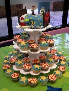 Homemade Andy's Bed Toy Story Birthday Cake: The bed is a two layered surrounded by cupcakes