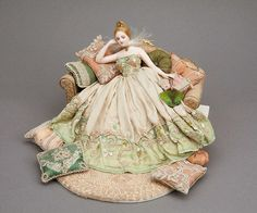 Elegant lady reclining on a settee by the very talented Gale Elena Bantock at the Good Sam Showcase of Miniatures
