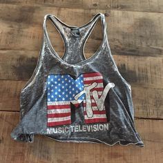 MTV crop top tank vintage look Vintage us flag re rehire and blue mtv logo shirt - purchased in London and has no brand . Size small like new- large arm holes- need a bandeau or sport bra underneath probably. flag Mtv Tops Tank Tops