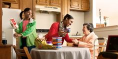 A sister and her daughter bring food to an elderly sister