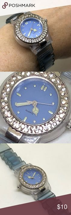 "Avon Retro Rhinestone Blue Jelly Watch An approx 9 1/4"" long watch in a semi-translucent blue ""jelly"" style, with a 1"" in diameter face ringed with rhinestones. The face is a bright blue, with a ""Peace"" symbol on one of the hands of the watch. In perfect working order! I'm not sure of the age; it was part of an Estate collection. It cleaned up nicely with only minor signs of wear. If you need a cute little workhorse of a watch, here it is!! Avon Accessories Watches"