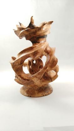 """Olive wood sculpture by Asaf Man """"pomegranate in pomegranate""""."""