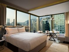 99 Bonham Hotel Located In Hong Kong Bedroom Suite overlooking the city of Hong Kong