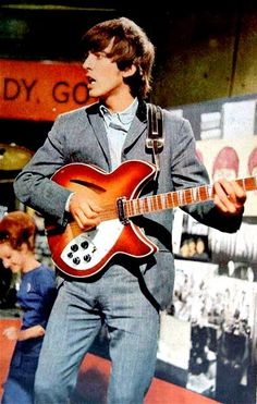 What's cooler - the George or the guitar? Tough choice :) Does anyone know just what that guitar is? I don't seem to be able to recognize it.