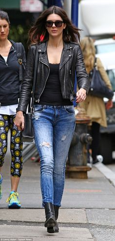 It girl: The 18-year-old flaunted her rocker outerwear over a black lacy tank top, ripped jeans and black ankle length boots