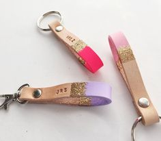 Custom color and gold glitter dipped leather keychain with optional hand-stamped personalization. • Please select whether you would like to add