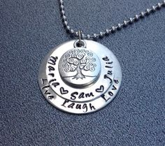 A personal favorite from my Etsy shop https://www.etsy.com/listing/208595501/hand-stamped-family-tree-necklace-hand