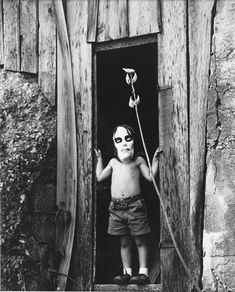 Untitled [Masked Boy Standing in Doorway] by Ralph Eugene Meatyard, 1959~♛