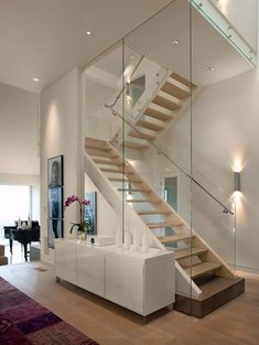 Modern staircase wall design glass staircase wall designs with a graceful impact on the overall decor Interior Stairs, House Design, Hillside House, House Interior, Staircase Design, Home, Glass Stairs, Modern Stairs, Modern House