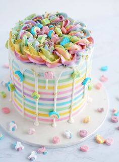 This Rainbow Cake, complete with a marshmallow frosting and Lucky Charms cereal, is the perfect show-stopper for your upcoming St. Patrick's Day celebration! Lucky Charms Cereal, Rainbow Food, Cake Rainbow, Rainbow Birthday Cakes, Rainbow Frosting, Marshmallow Frosting, White Cake Mixes, Drip Cakes, Savoury Cake