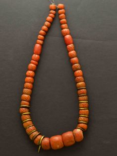 Nigeria | Necklace made from sand glass beads (imitation coral) and brass rings | Est. 200 - 400 CHF (Nov '13) | Restrung in 1974.
