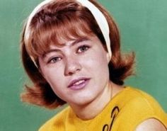 Patty Duke was in Style with the Wide Headband and the Flip Do.