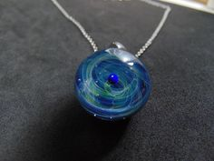 Tiny galaxy pendant necklace for women and men, Silver fumed Borosilicate space necklace, with a floating opal planet, Blue Galaxy Pendant Green And Purple, Blue, Glass Pendants, Opal, Bronze, Pendant Necklace, Chain, Silver, Stuff To Buy