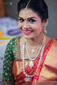 South Indian bride. Diamond Indian bridal jewelry.Temple jewelry. Jhumkis.Red silk kanchipuram sari with contrast green blouse.braid with fresh jasmine flowers. Tamil bride. Telugu bride. Kannada bride. Hindu bride. Malayalee bride.Kerala bride.South Indian wedding.