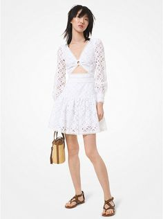 Michael Kors Lace Dress ~ Feminine and flirty, the Michael Kors White Lace Cutout Dress is crafted from geometric lace with delicate eyelet trim. It's lined through the body to create an alluring reveal-and-conceal effect and finished with a clean zip fastening. A change of shoes is all you need to take this piece from day to night. | White Lace Dress | Michael Kors Lace Dress  | Micheal Kors Straw Tote | Michael Kors Sandals Cutout Dress, Lace Dress, Casual Dresses For Women, Dresses For Work, Woman Dresses, Summer Dresses, Cruise Dress, Cruise Outfits, Vacation Outfits
