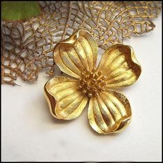 Trifari Pin Gold Dogwood Flower Brooch 1950s Vintage Jewelry   http://www.greatvintagejewelry.com/inc/sdetail/trifari-pin-gold-dogwood-flower-brooch--1950s-vintage-jewelry/15237