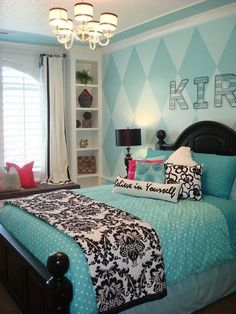 "A nicely put-together turquoise and black room, saved from ""too much"" by small amount of black, the patterned headboard wall, a fair amount of crisp white, and a couple subtle pops of raspberry.  Black bed actually grounds the turquoise well."
