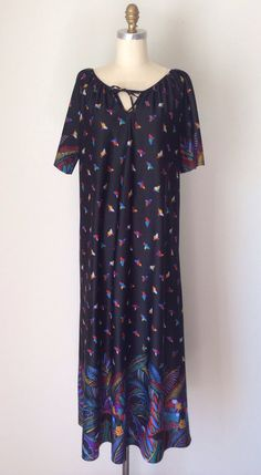 Wild Side Black Maxi house dress // Vintage 70s Hippie Nightgown with v-neck // Black boho Moo Moo size small with Tribal African print on Etsy, $40.00