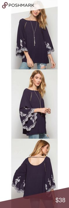 3/4 Sleeve Embroidery Scalloped Tunic 3/4 sleeve tunic top with scalloped sleeves and embroidery detail and trim at front. Color Navy She and Sky Tops Tunics