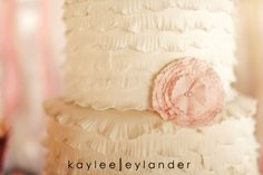 Oh, so pretty.  A cake in pink and cream decorated to look like soft fabric.