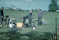 Me-109's and ground crew at an advance base somewhere in western Europe,1939.