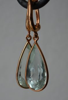 Green Aquamarine Elongated Pear Dangly Earrings in 14K Rose Gold. $699.00, via Etsy.