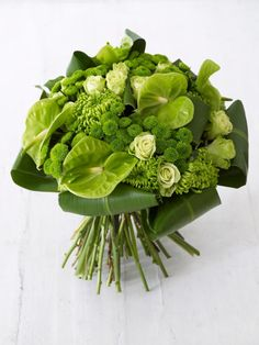 With its limited, neutral palette of hues, this hand-tied bouquet suits any room, whether colorful or pristine white. It is also an ideal gift for someone who might prefer a more contemporary arrangement.