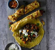 These savoury Indian pancakes are traditionally eaten for breakfast or as a tasty snack. Our vegetarian spiced sweet potato filling is complemented with cooling coconut and coriander yogurt