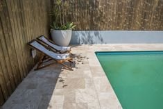 Travertine pavers are low-maintenance and easy on the eyes, even on the brightest of Australian days.  #outdoorpavers #naturalstone