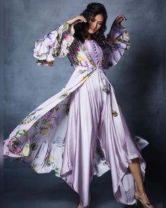 FLAT Off Primped with florals for a chic essence, this pastel jacket style ensemble by Riraan couture is a stunner by all means. WhatsApp us now for a personal shopping experience! Pastel Jacket, Floral Jacket, Stylish Dresses, Fashion Dresses, Women's Fashion, Indian Fashion, Kurti With Jacket, Ethenic Wear, Designer Bridal Lehenga