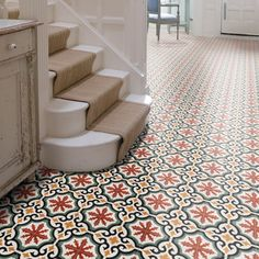 Ca'Pietra Encaustic Salisbury Pattern Tile. Salisbury cement encaustic tile by Ca'Pietra is a beautiful floral pattern with shades of red, blue and gold. The tiles are handmade using natural materials and are suitable for interior walls and floors.
