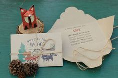 Woodland Invitations. Create invites with character by wrapping them in twine and garnishing with pinecones.